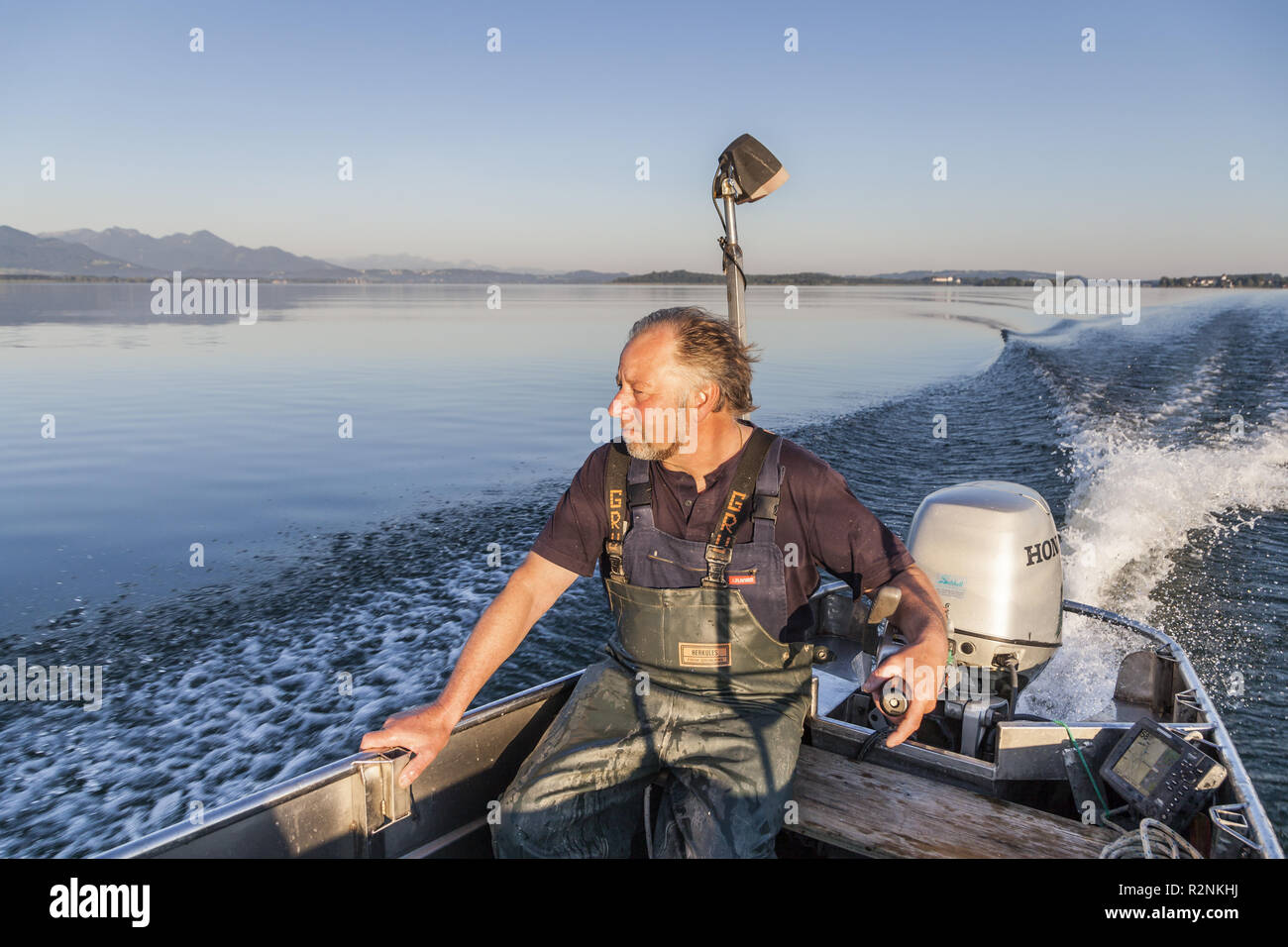 Fisher Thomas Lex from Fraueninsel on a cruise across Chiemsee, Frauenchiemsee, Chiemgau, Upper Bavaria, Bavaria, Southern Germany, Germany, Europe - Stock Image