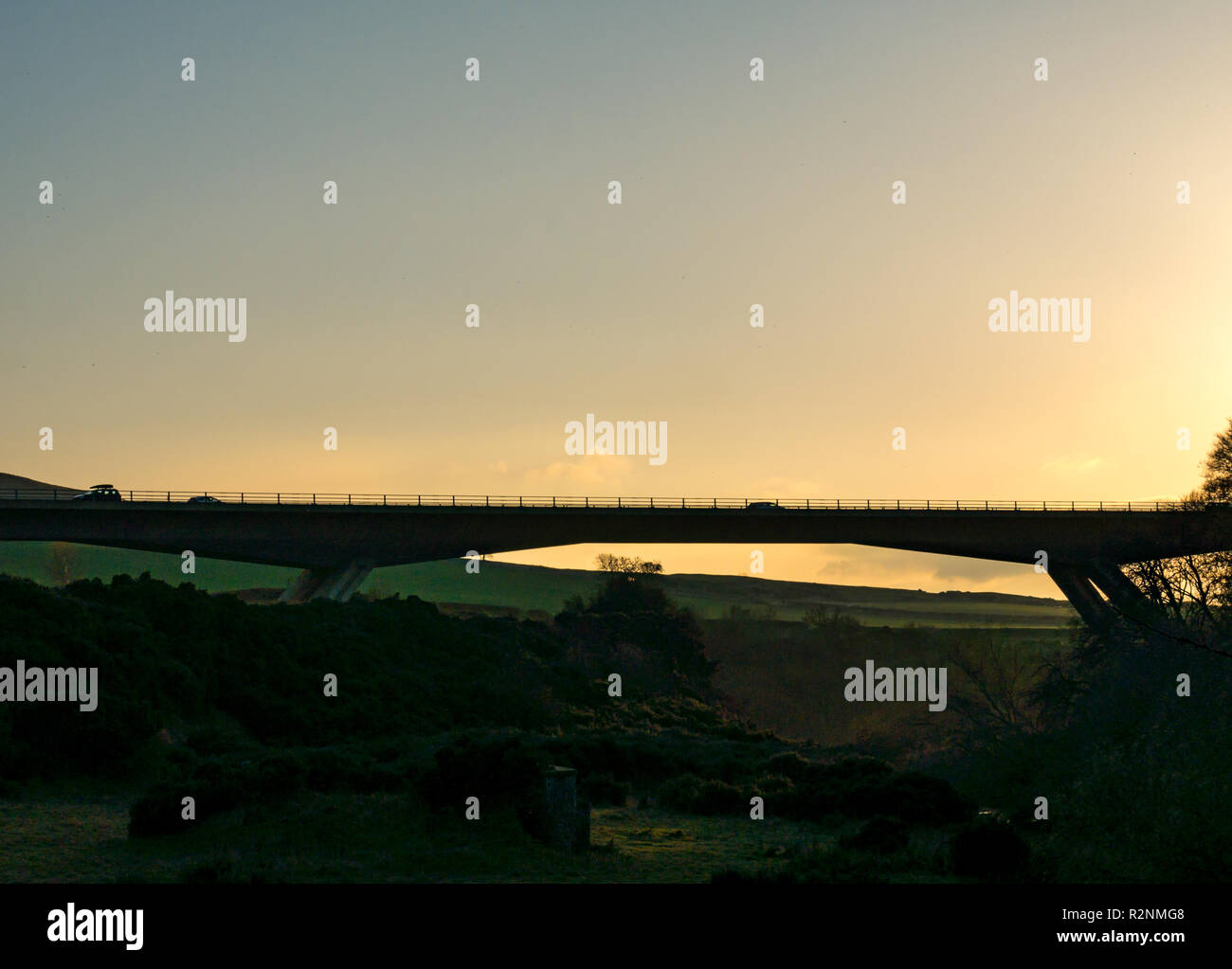 Car driving on A1 River Tyne concrete flyover bridge silhouette by Balfour Beatty Civil Engineering, East Lothian, Scotland, UK - Stock Image