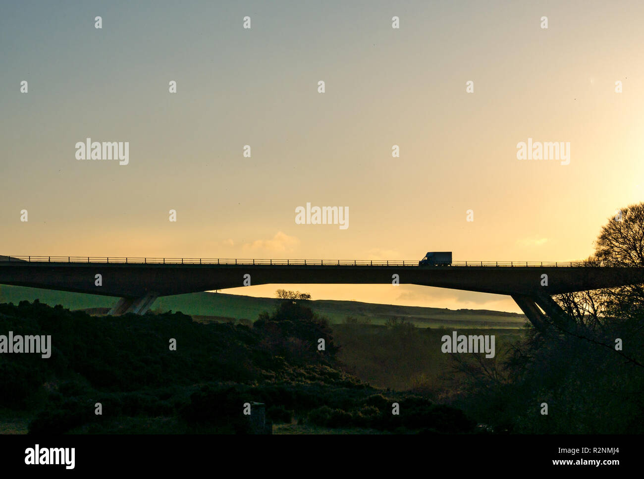 Van driving on A1 River Tyne concrete flyover bridge silhouette by Balfour Beatty Civil Engineering, East Lothian, Scotland, UK - Stock Image
