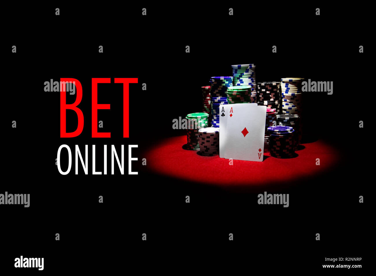Poker cards gambling chips on red table with message BET