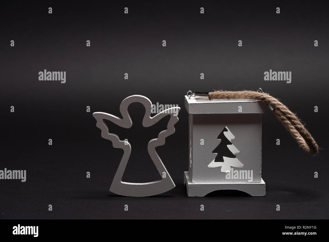 Wooden angel with candle holder box with christmass tree cutout. Seasonal decorations for winter holiday Stock Photo
