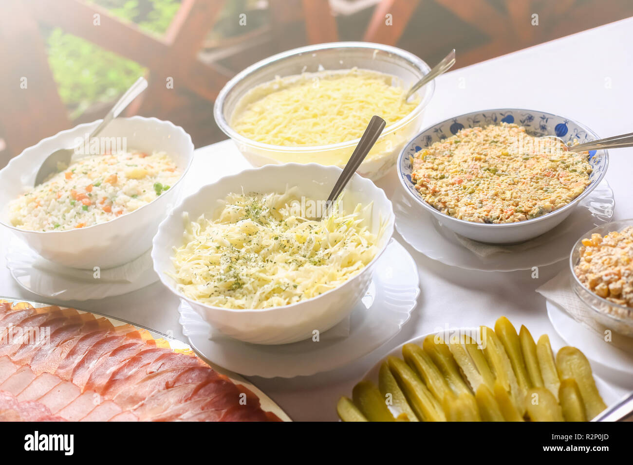 Different types of delicious salads. Wedding day food table. Stock Photo