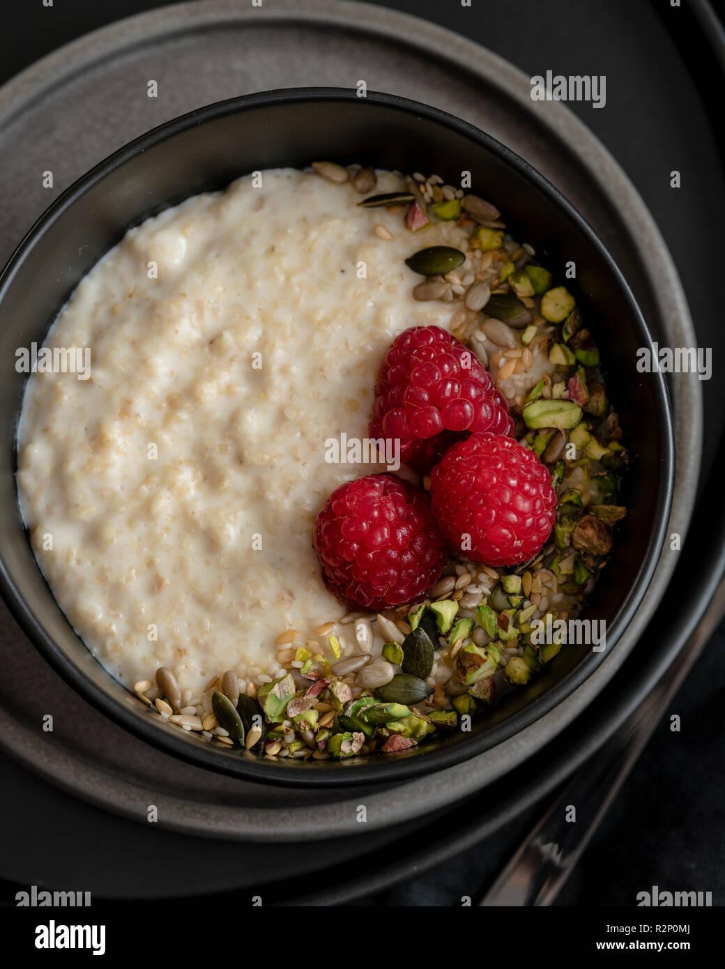 breakfast porridge in dark bowl - Stock Image