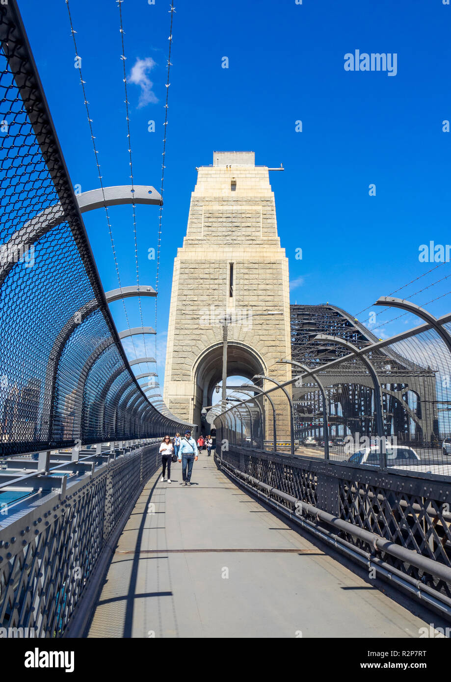Pedestrians walking on pathway on the Sydney Harbour Bridge Sydney NSW Australia. - Stock Image