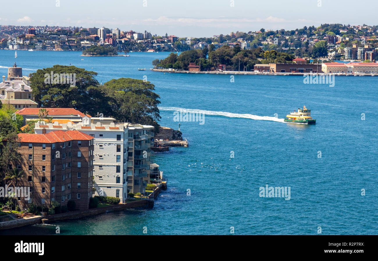 Sydney Harbour ferry passing by luxury residential dwellings in Kirribilli North Shore, Sydney NSW Australia. - Stock Image