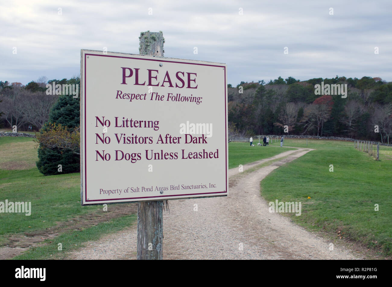 Sign stating Please Respect the Following: No Littering, No Visitors After Dark and No Dogs Unless Leashed at Bourne Farm, Falmouth, Cape Cod - Stock Image