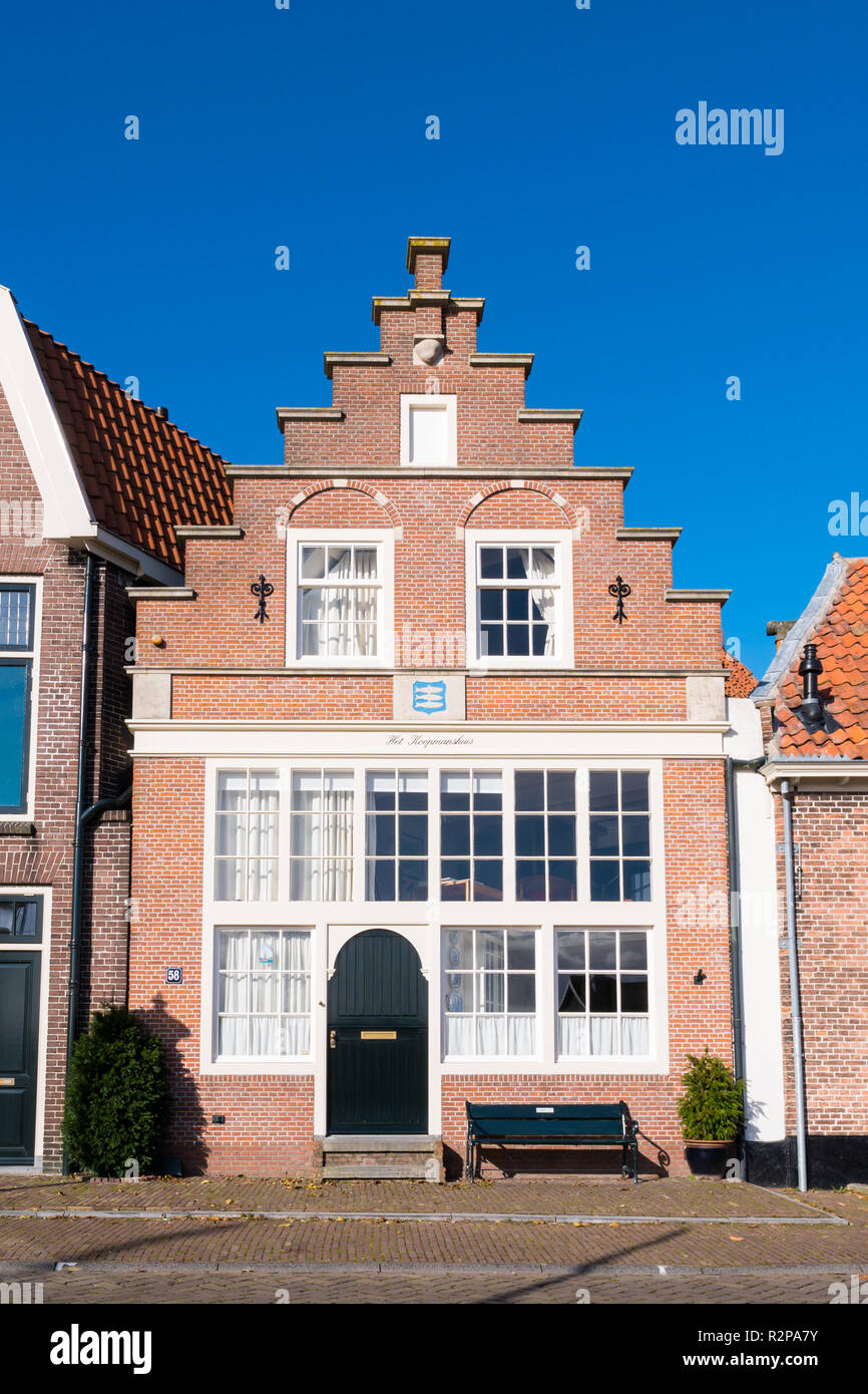 Historic house with stepped gable in old town of Enkhuizen, Noord-Holland, Netherlands - Stock Image