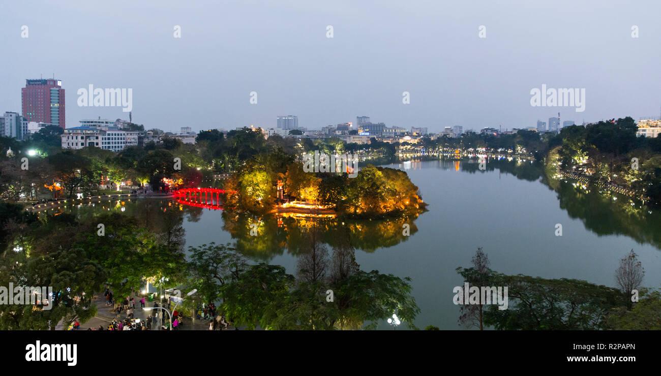 Hoan Kiem Lake in Hanoi in the evening, illuminated shore and illuminated bridge, island Ngoc Son Temple), from above, panorama - Stock Image