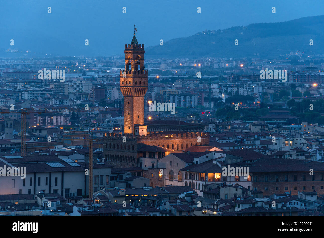 Florence, Palazzo Vecchio at the blue hour, distant view - Stock Image