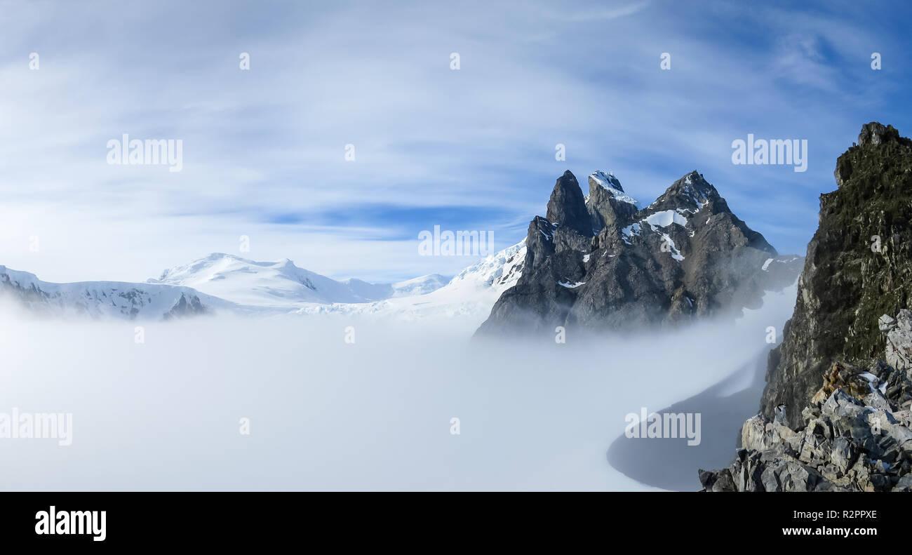 View of Orne Harbour glacier in mist from Spigot Peak, Antarctic Peninsula, Antarctica Stock Photo