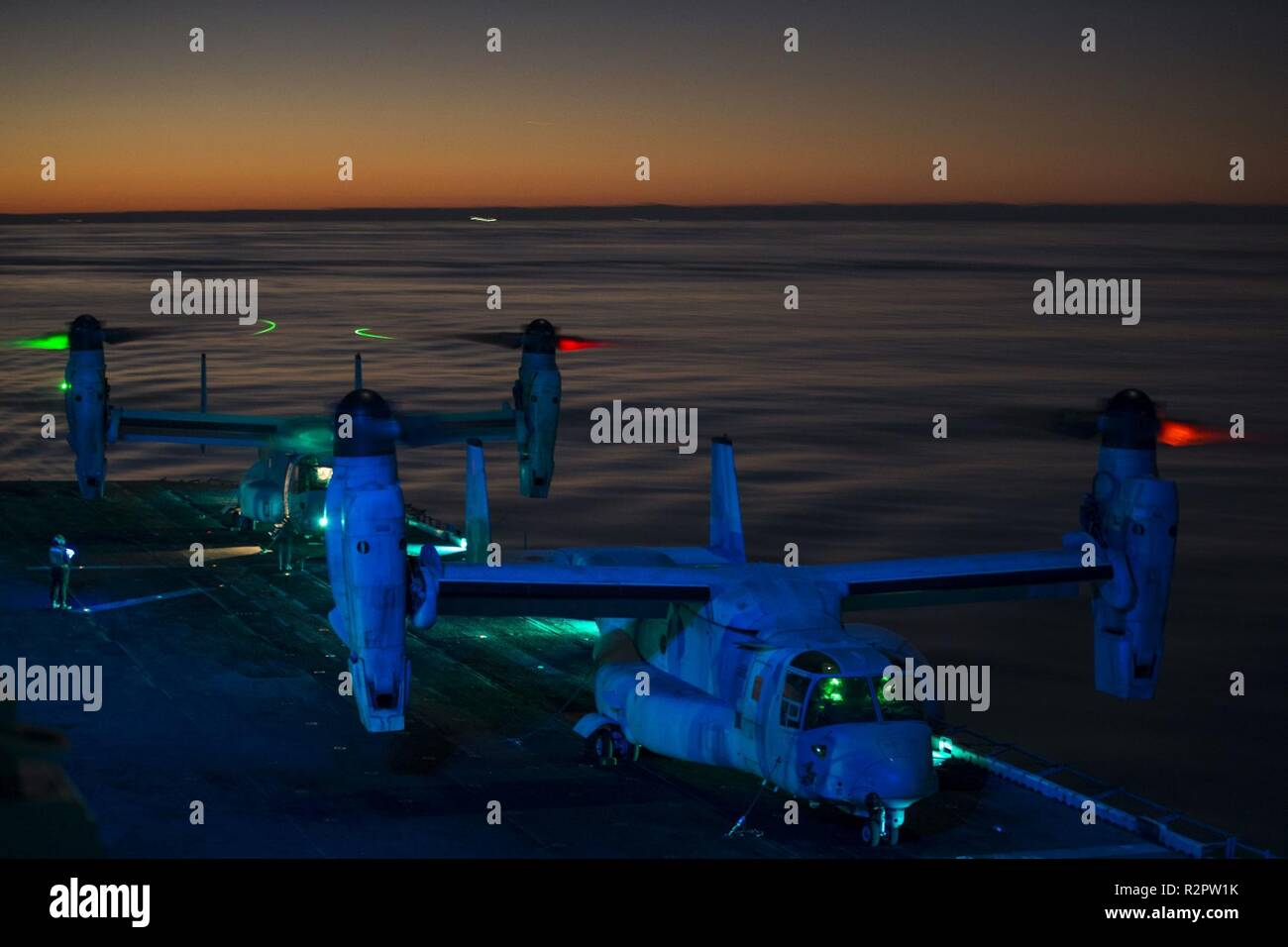Two MV-22 Ospreys with Marine Medium Tiltrotor Squadron 264 (Reinforced), 22nd Marine Expeditionary Unit, prepare for takeoff prior to executing an amphibious assault training exercise during the Carrier Strike Group 4 composite training unit exercise (COMPTUEX) aboard the Wasp-class amphibious assault ship USS Kearsarge (LHD 3), Oct. 18, 2018. COMPTUEX is the final pre-deployment exercise that certifies the combined Kearsarge Amphibious Ready Group and 22nd Marine Expeditionary Unit's abilities to conduct military operations at sea and project power ashore through joint planning and execution Stock Photo