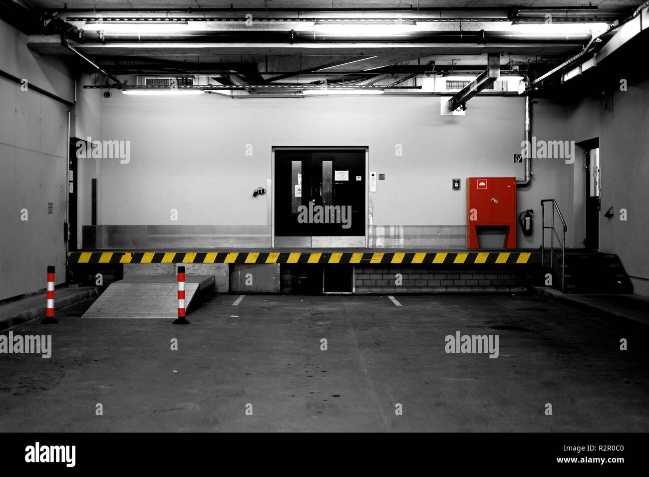 Loading ramp of a commercial building with fire safety equipment - Stock Image