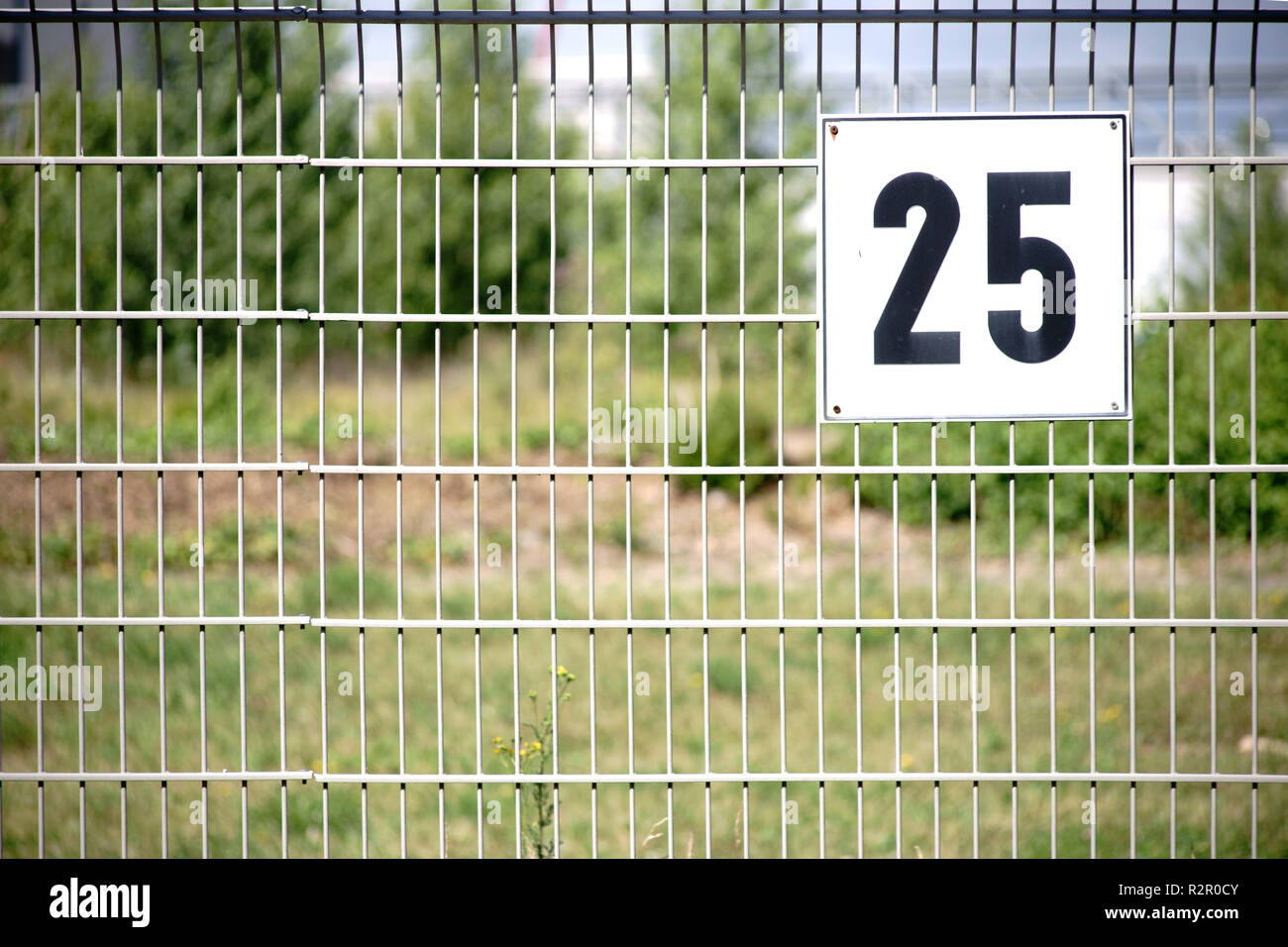 Fence, detail, with number of the fenced plot - Stock Image