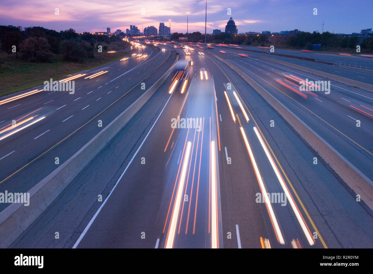 North America, Canada, Ontario, Toronto, traffic on highway 401 at dusk, one of busiest highways in world - Stock Image