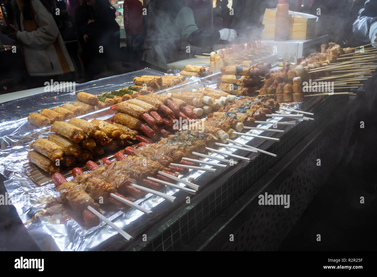Street Food On Wooden Sticks Or Skewers On A Stall In Myeongdon In