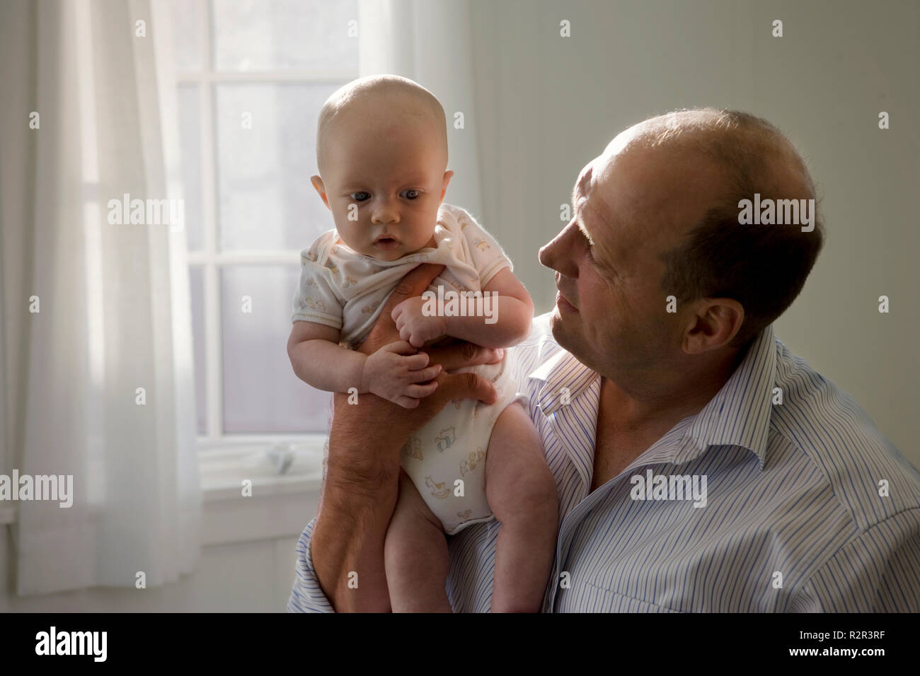 Mid-adult man and his young son. - Stock Image