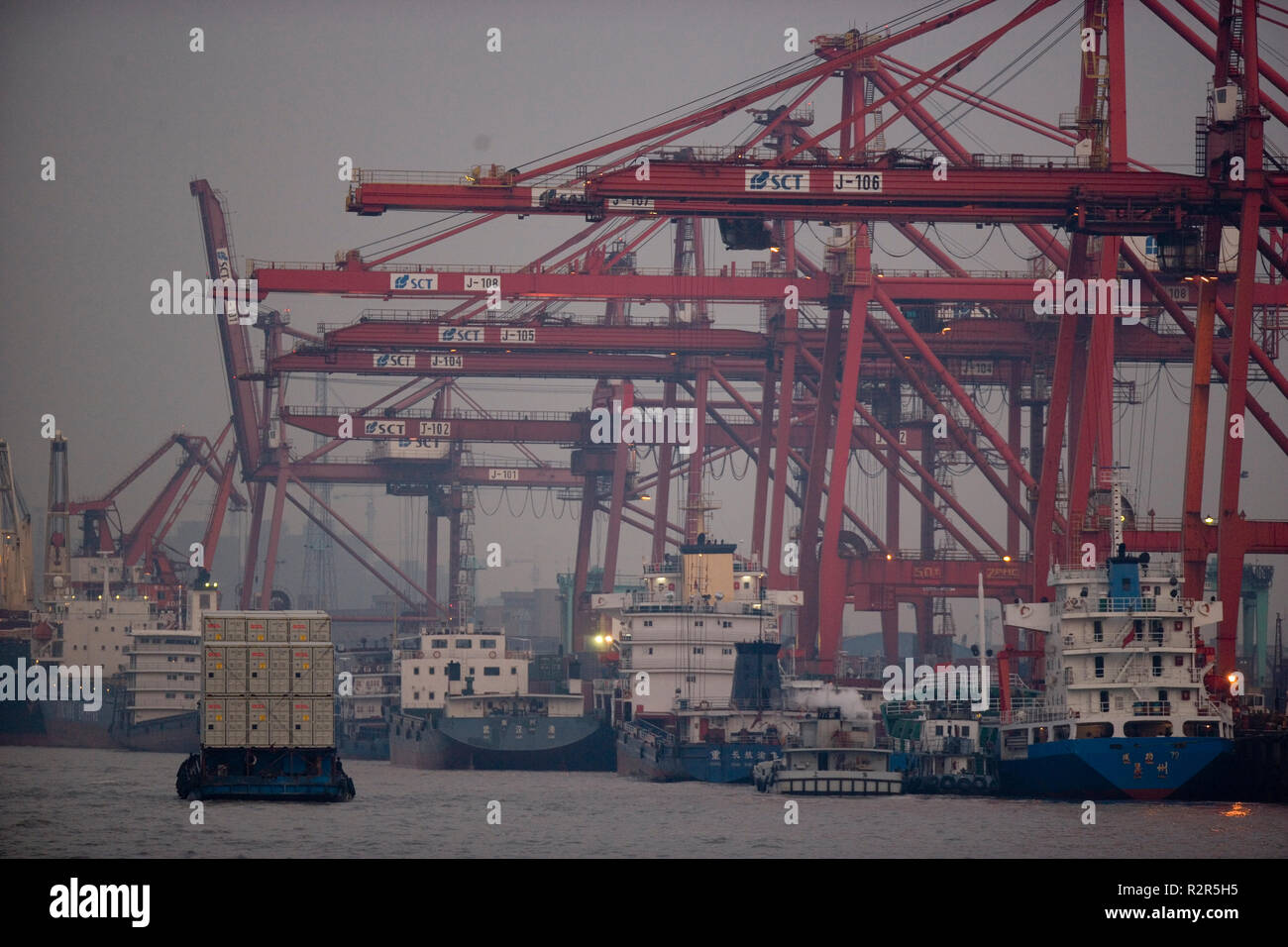 Container ships docked in a shipping port. - Stock Image