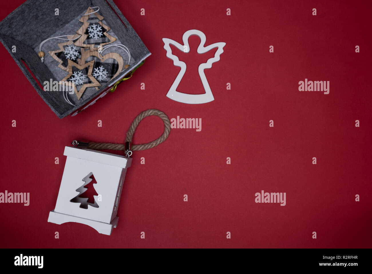 Christmas box, candle holder and wooden angel cutout Conceptual minimalistic flat lay Stock Photo