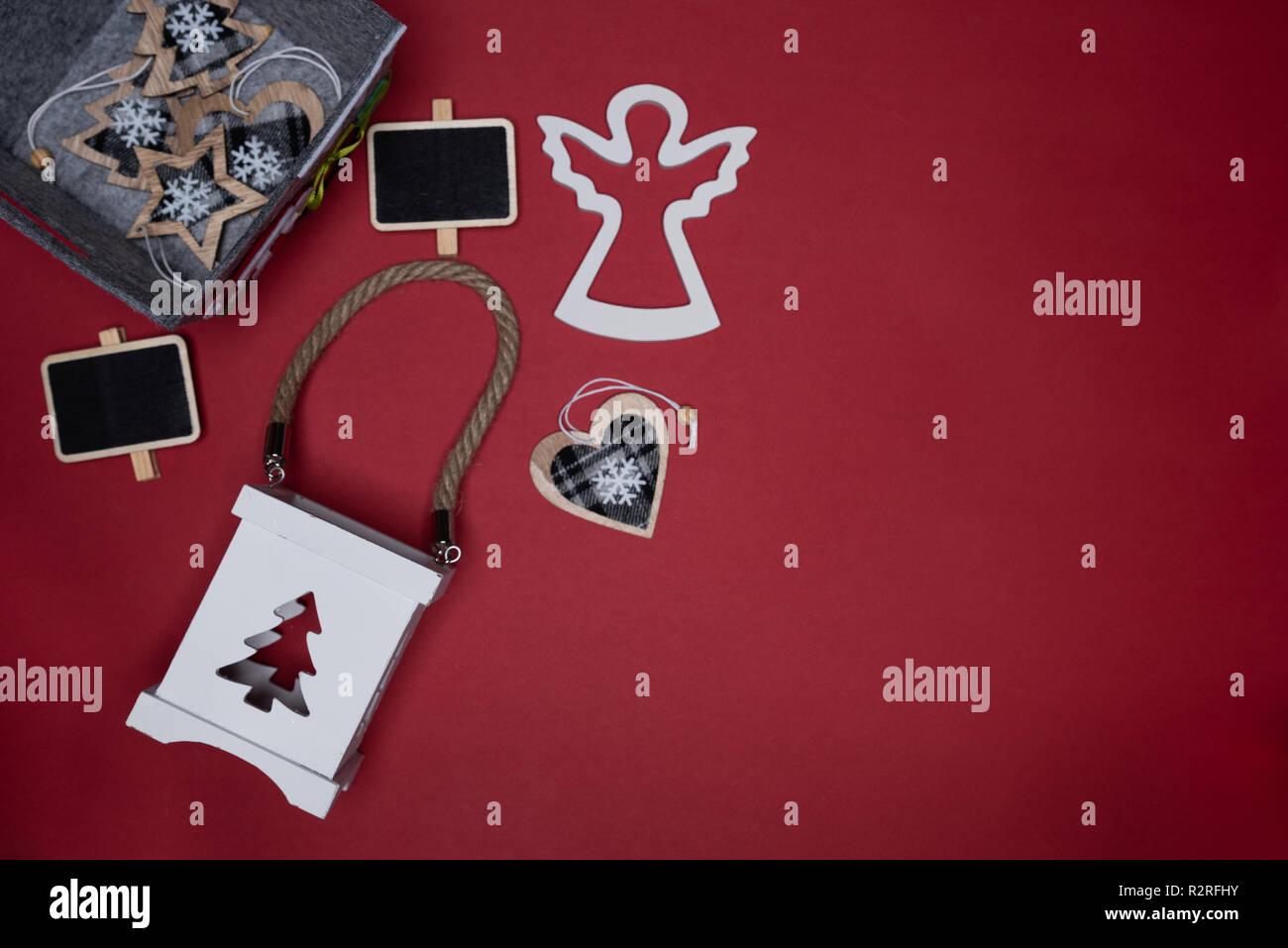 Christmas box, candle holder, heart, mini chalk board and wooden angel cutout. Conceptual minimalistic flat lay Stock Photo