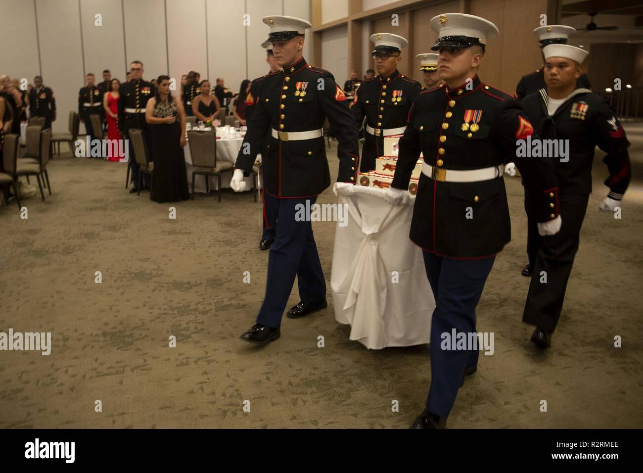 US Marines And Sailors With Marine Aircraft Group 24 March In The Birthday Cake During Units Ball Celebration Honolulu Hawaii Nov 3 2018