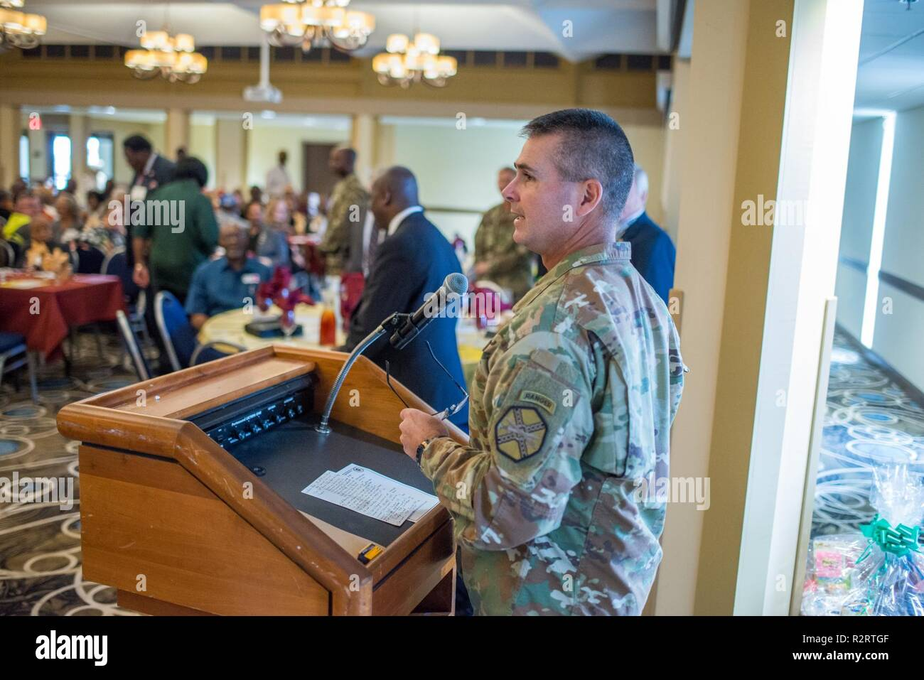 FORT BENNING, Ga. (Nov. 7, 2018) – Col. Clinton W. Cox, U.S. Army Garrison Fort Benning commander, talks to retirees about Fort Benning's training mission and its centennial celebration. Veterans of the U.S. military from Georgia and Alabama attended the annual Retiree Appreciation Day event Nov. 2 and the Benning Club at Fort Benning, Georgia. The event provides retirees and their Family members the information on policy updates, the opportunity to network with one another, the chance to renew ID cards, receive medical checkups, and more. - Stock Image
