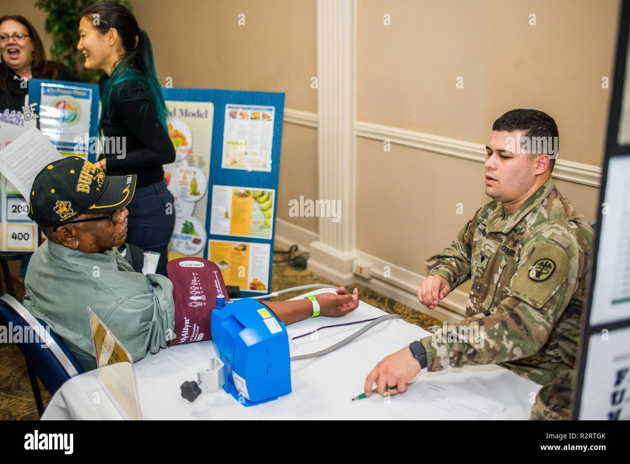 FORT BENNING, Ga. (Nov. 7, 2018) – Veterans of the U.S. military from Georgia and Alabama attended the annual Retiree Appreciation Day event Nov. 2 and the Benning Club at Fort Benning, Georgia. The event provides retirees and their Family members the information on policy updates, the opportunity to network with one another, the chance to renew ID cards, receive medical checkups, and more. - Stock Image