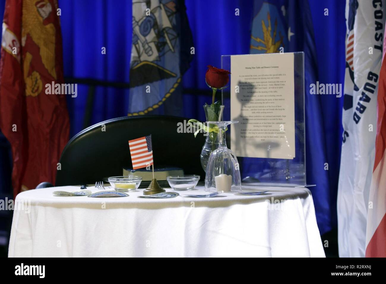 The Missing Man Table is explained to attendees of the U.S. Department of Housing and Urban Development's 2018 Veteran's Day ceremony, hosted by the Honorable Dr. Ben Carson, secretary of HUD, on Nov. 8, in Washington, D.C. The table remembers and honors the missing in action and prisoners of war. Stock Photo