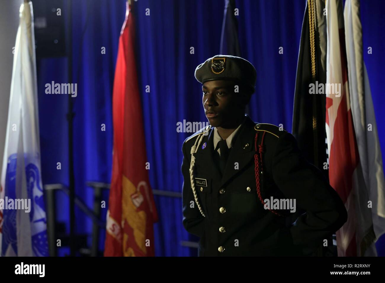 An Army JROTC cadet stands guard at the Missing Man Table during the U.S. Department of Housing and Urban Development's 2018 Veteran's Day ceremony, hosted by the Honorable Dr. Ben Carson, secretary of HUD, on Nov. 8, in Washington, D.C. The ceremony commemorated the centennial of Armistice Day and celebrated the Veterans working at HUD. Stock Photo