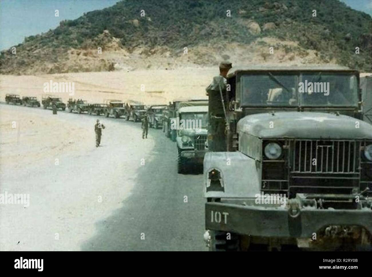 SAIGON, Vietnam - The 1st Logistical Command 379th Transportation Company line up in a convoy to deliver food and ammo to the Soldiers on the frontlines, circa 1969. The trucks, known as the minesweepers ran ahead of the group, providing logistical support against the North Vietnamese Communist regime. - Stock Image