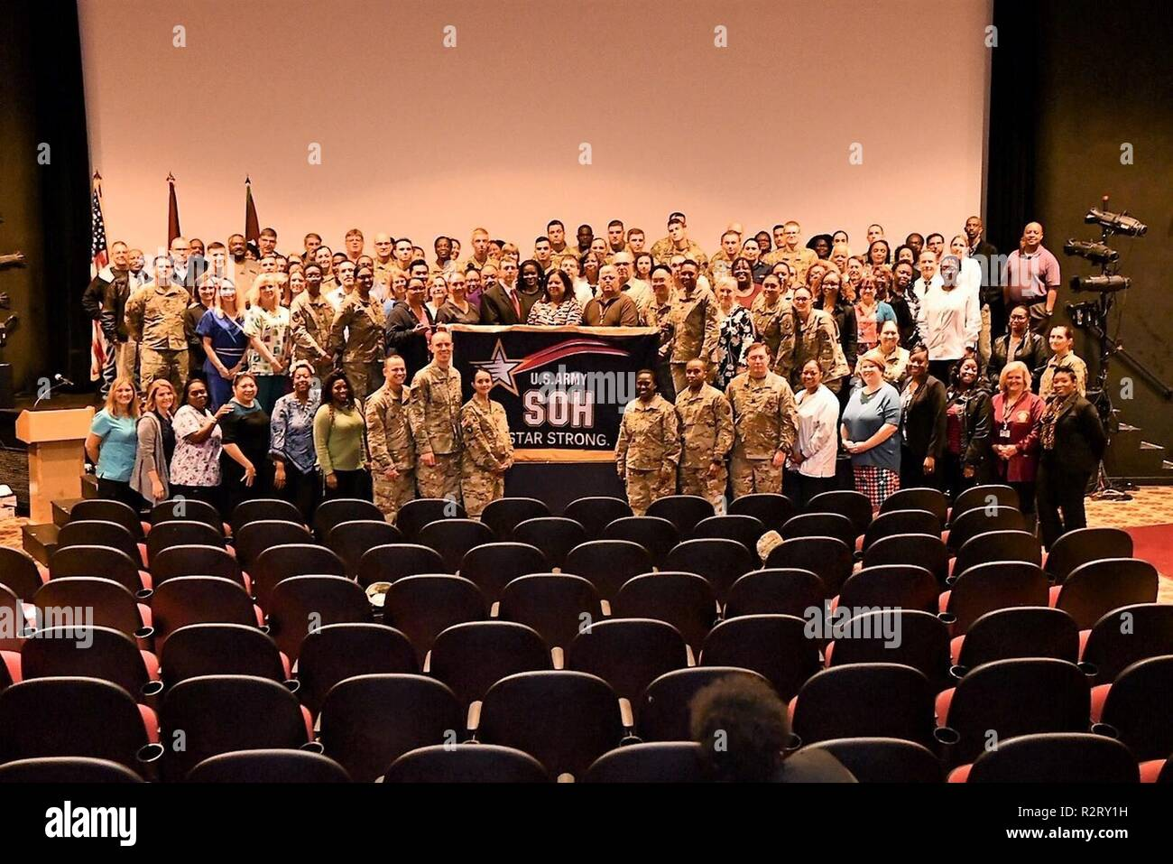 - Brig. Gen. Telita Crosland, Regional Health Command-Atlantic, commanding general stands with the Kenner Army Health Clinic team with the Army Safety and Occupational Health Star flag, which was presented during Commander's Call at the Fort Lee Theater Nov. 8. - Stock Image