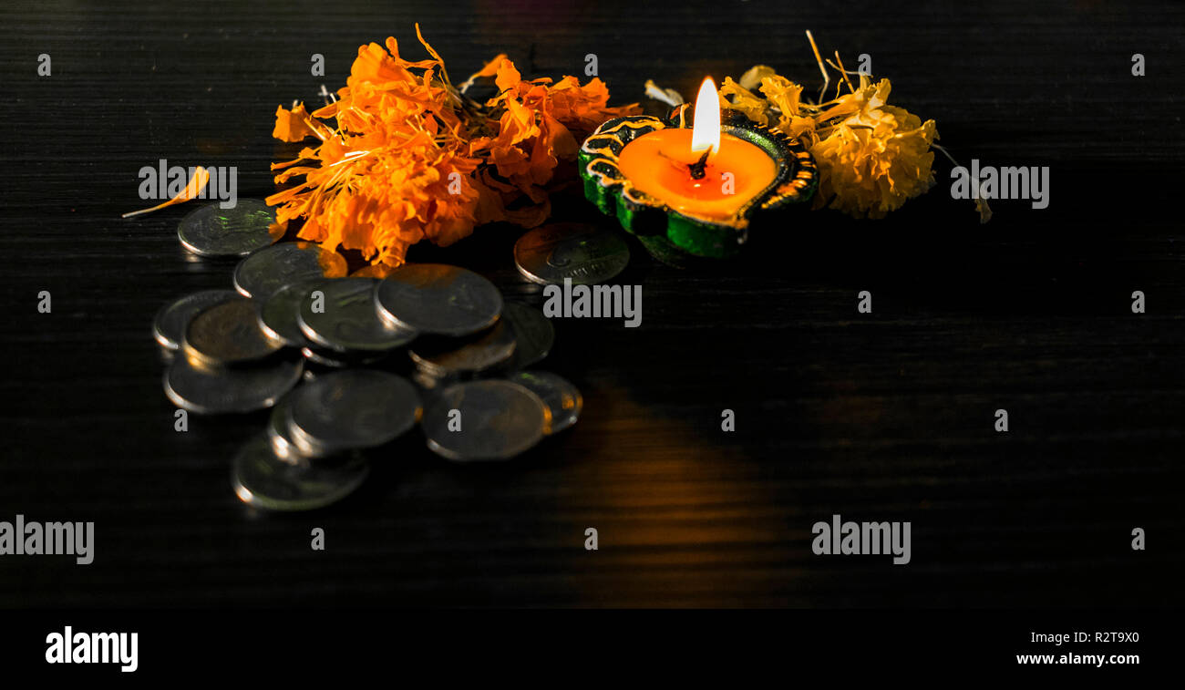 Illuminated diya arranged for celebrating diwali and dhanteras in India Stock Photo