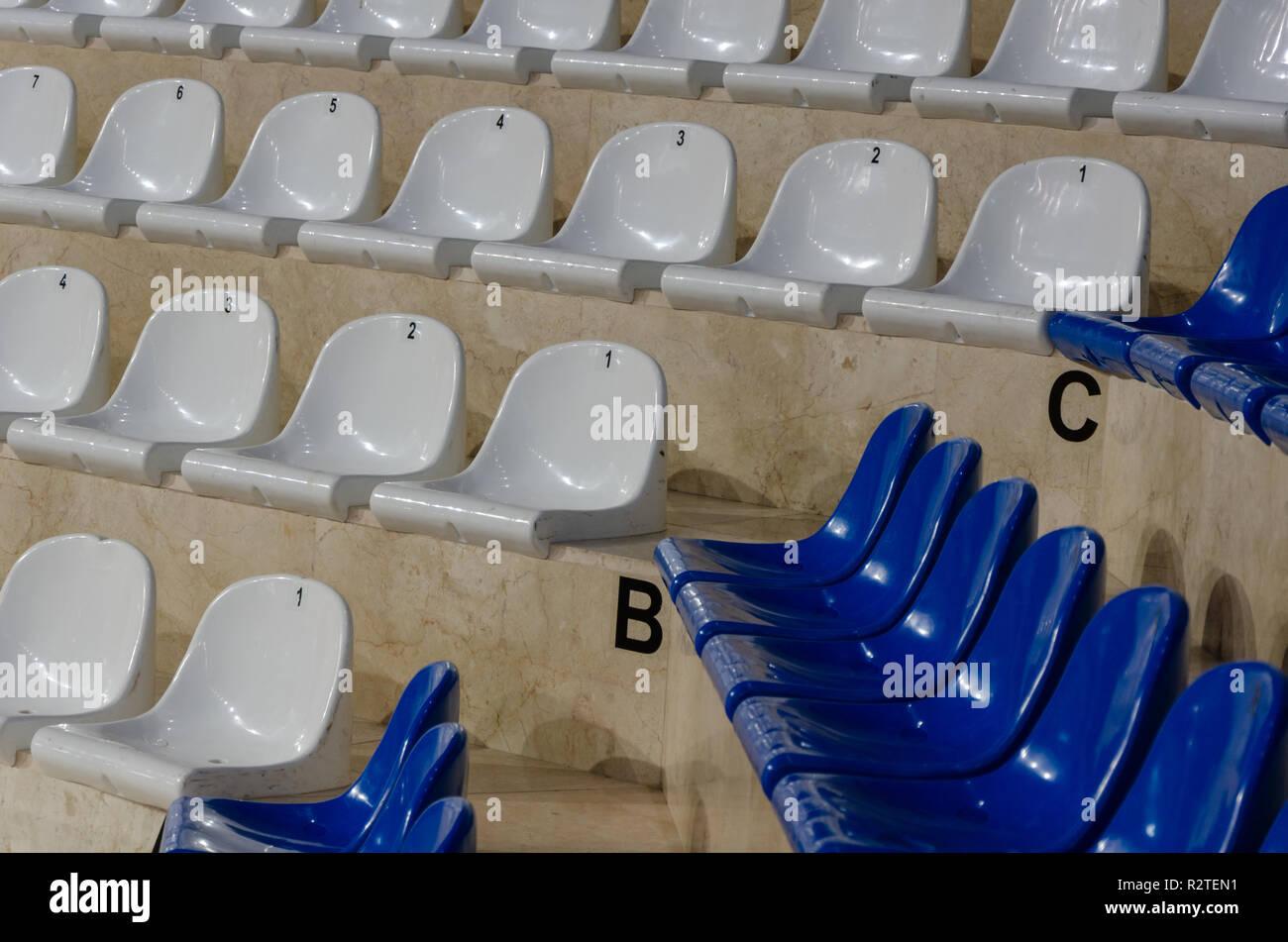 Empty blue and white  stadium seats, - Stock Image