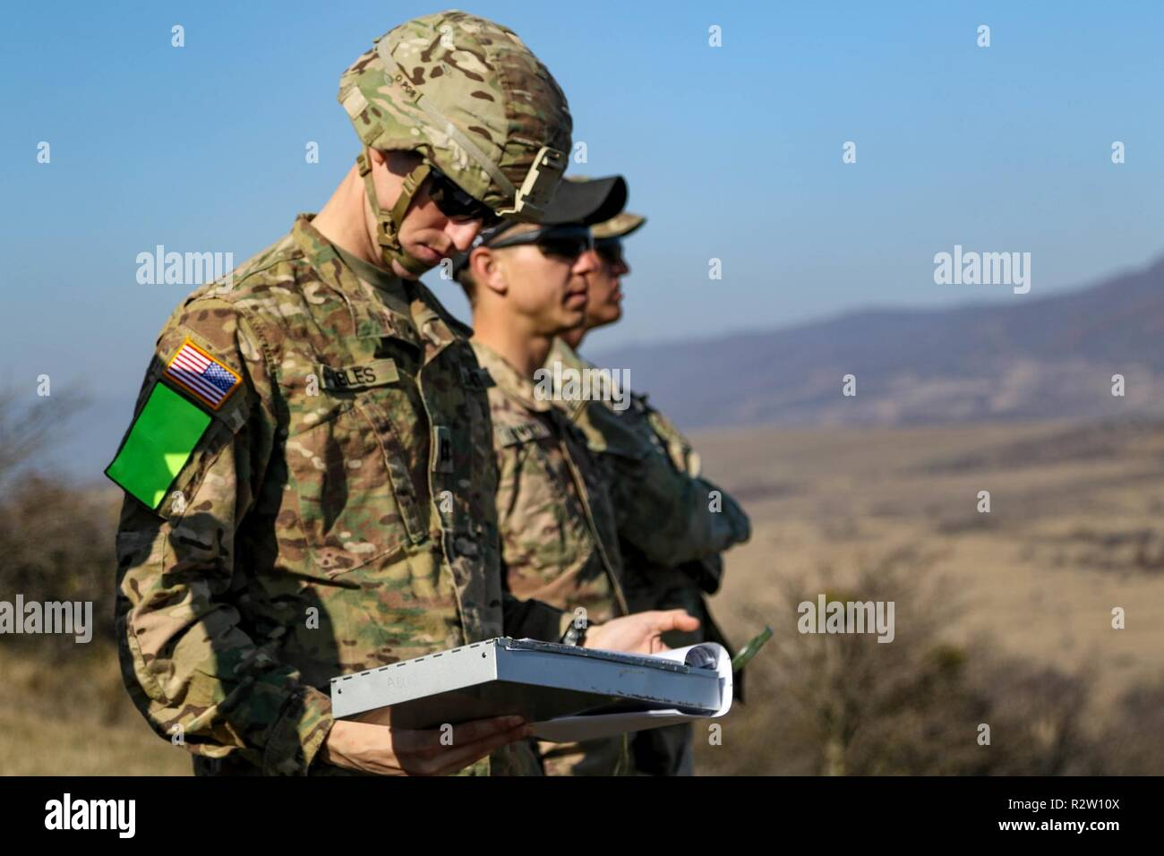 U.S. Army Cpt. Micah Ables, Sgt. Nathan Lockwood, and 1st Lt. Kendell Williams with 2nd Battalion, 8th Cavalry Regiment, 1st Armored Brigade Combat Team, 1st Cavalry Division, conduct an area reconnaissance at Vaziani Training Area, Georgia on Nov. 11, 2018. 2-8 CAV assisted with the Georgia Defense Readiness Program - Training (GDRP-T) to improve interoperability with our allies and partners to increase lethality and maintain the advantage against future threats. - Stock Image