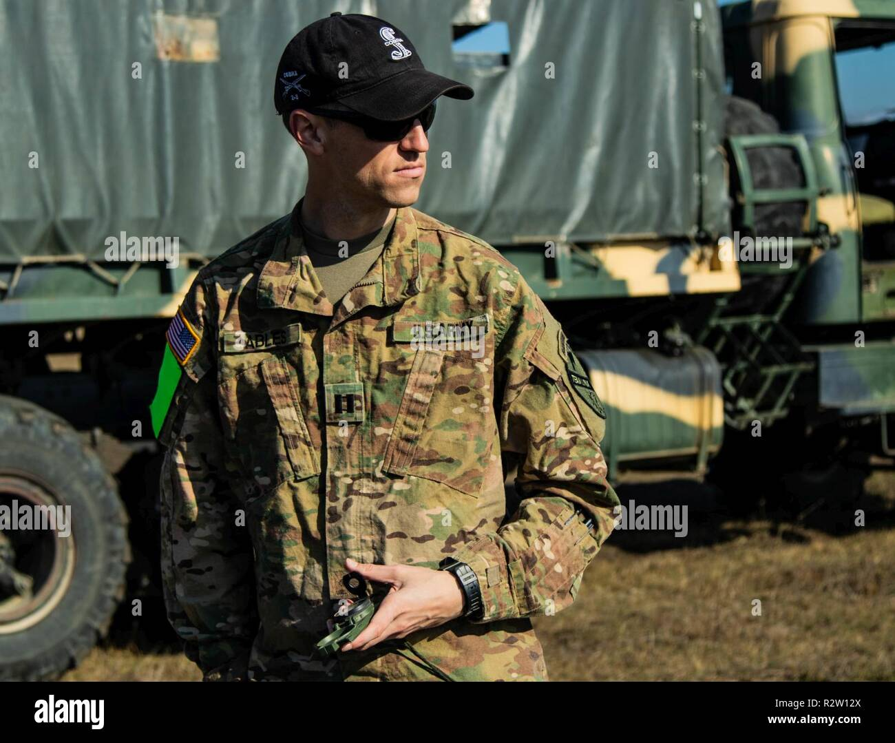 U.S. Army Capt. Micah Ables is a company commander with the 2nd Battalion, 8th Cavalry Regiment, 1st Armored Brigade Combat Team, 1st Cavalry Division, surveys terrain for an upcoming field exercise at Vaziani Training Area, Georgia on Nov. 11, 2018. 2-8 CAV assisted with the Georgia Defense Readiness Program - Training (GDRP-T) to improve interoperability with our allies and partners to increase lethality and maintain the advantage against future threats. - Stock Image