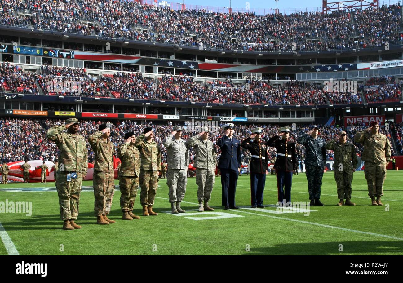 1b582077b Service members from all five branches salute during the National Anthem  Sunday at Nissan Stadium in