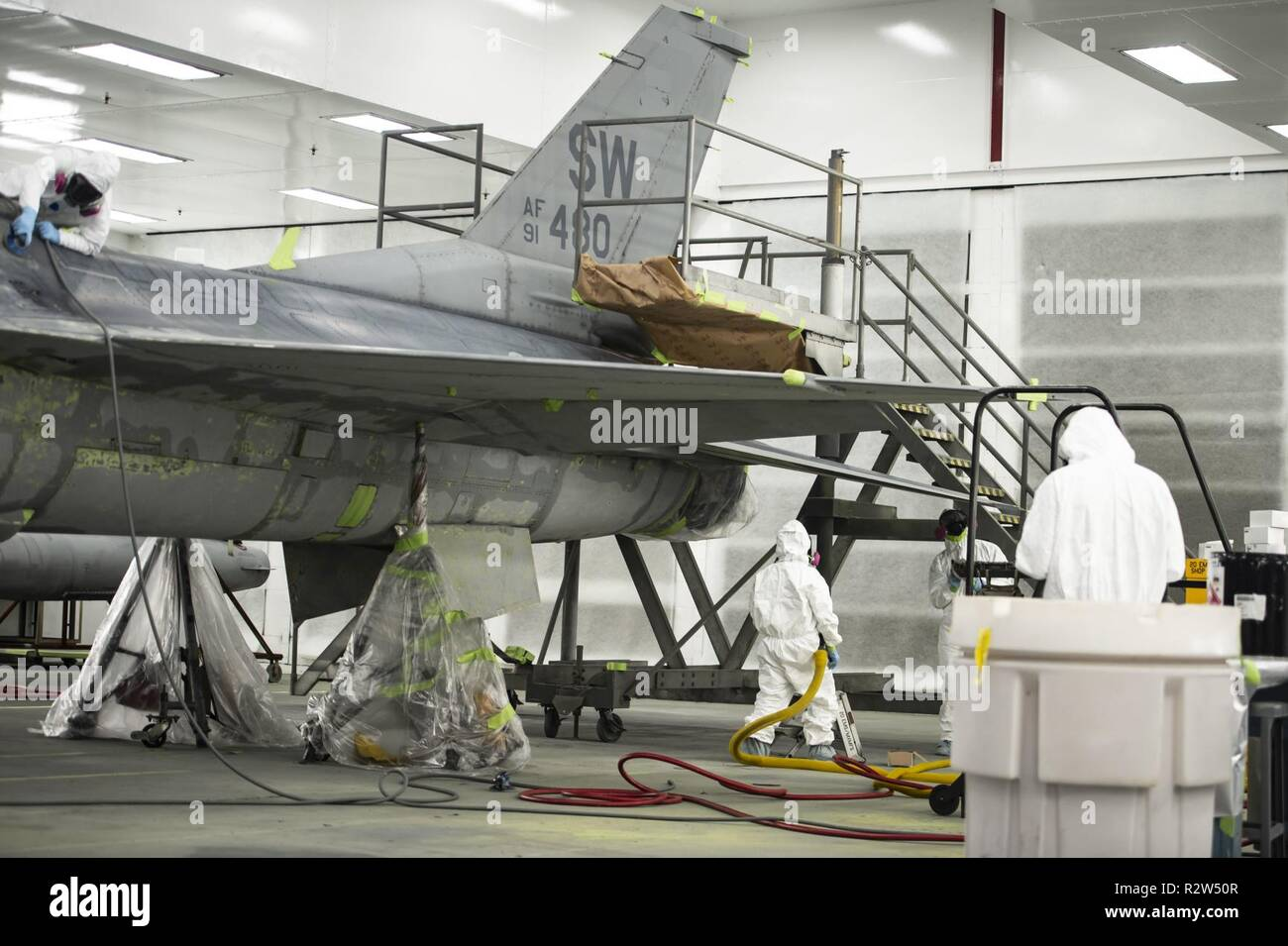 U.S. Airmen assigned to the 20th Equipment Maintenance Squadron corrosion control paint barn, work on an F-16CM Fighting Falcon at Shaw Air Force Base, S.C., Nov. 13, 2018. The maintenance performed on the aircraft helps protect the aircraft from the elements while stateside or overseas. Stock Photo