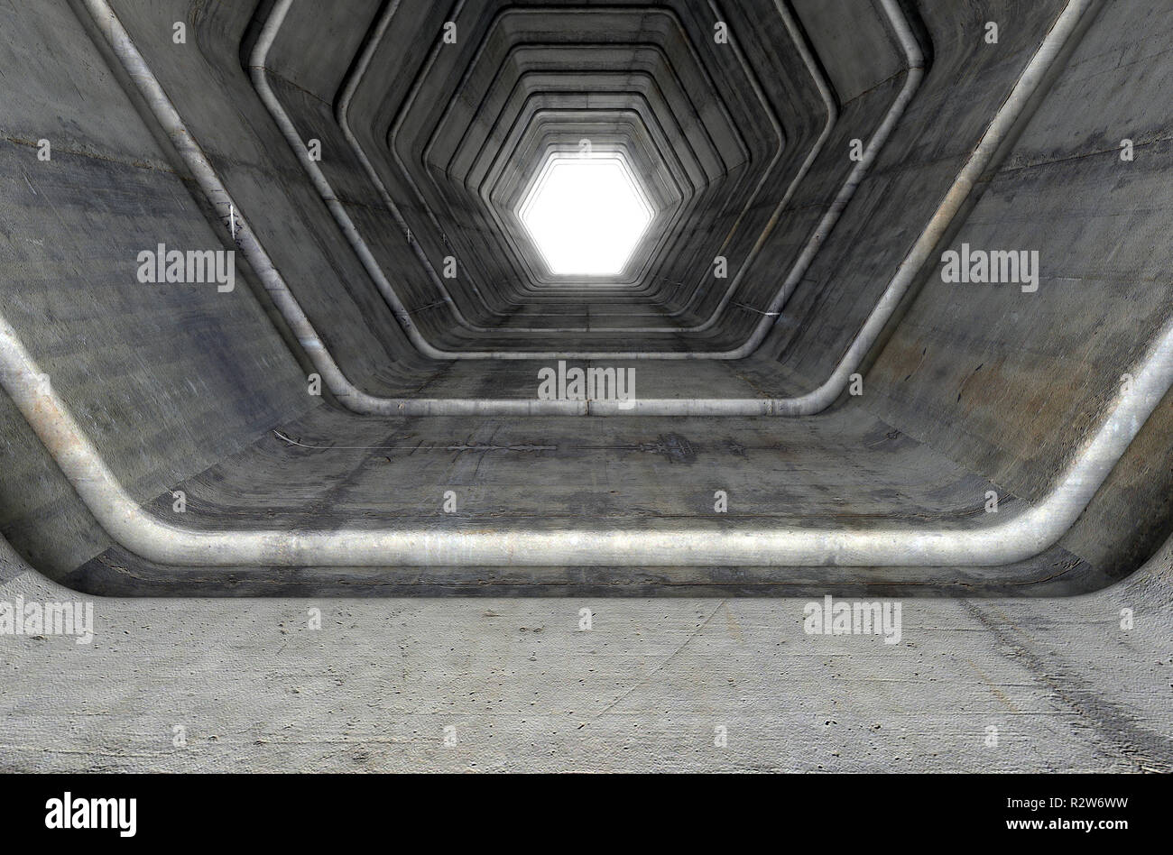 A look down a concrete tunnel made out of hexagonal geometric shapes with a light in the distance at the far end - 3D render Stock Photo