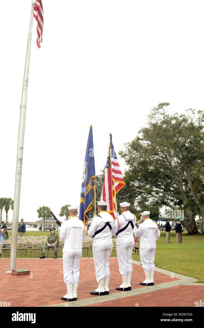 The Naval Submarine Base Kings Bay Color Guard parades the colors during the Veterans Council of the Golden Isles Veterans Day Parade in St. Simons Island, Georgia. The base is home to five of the Ohio-class ballistic-missile submarines that make up the most survivable leg of the nuclear missile triad. - Stock Image