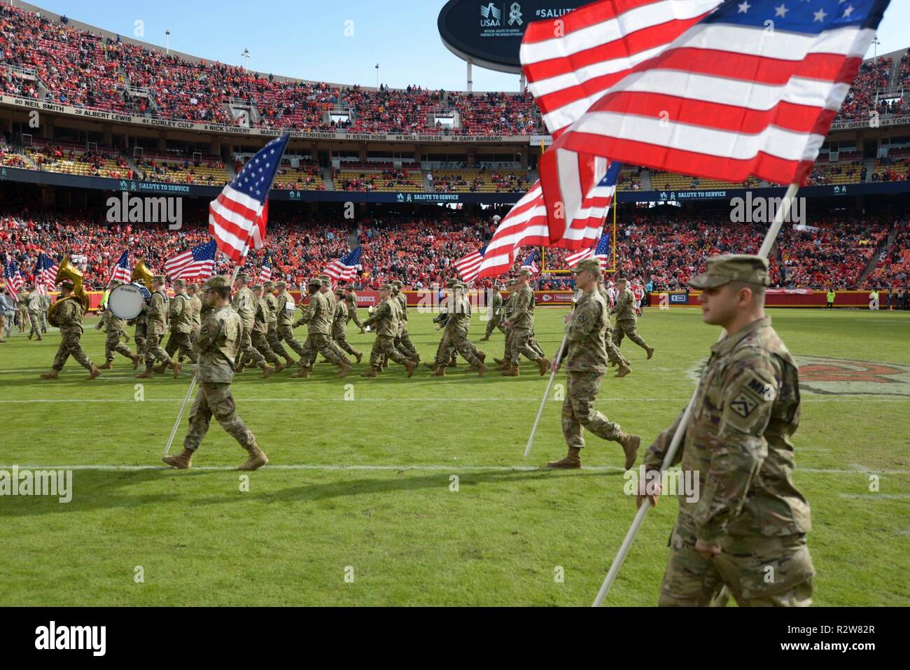 Servicemembers from the Kansas Army National Guard 35th Infantry Division Band walk off field after their halftime performance on Nov. 11, 2018 during the Chiefs football game at Kansas City, Missouri. The band in comprised of 40 band members based out of Olathe, KS. - Stock Image