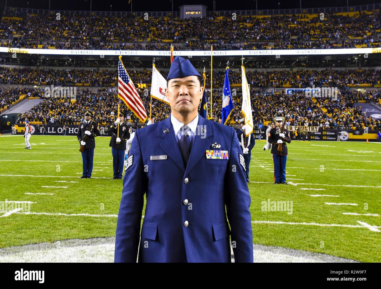 Former Air Force Staff Sgt. Mark Lindquist stands midfield before performing the national anthem in front of a joint services color guard during the NFL's production of Thursday Night Football Nov. 8, 2018. Stock Photo
