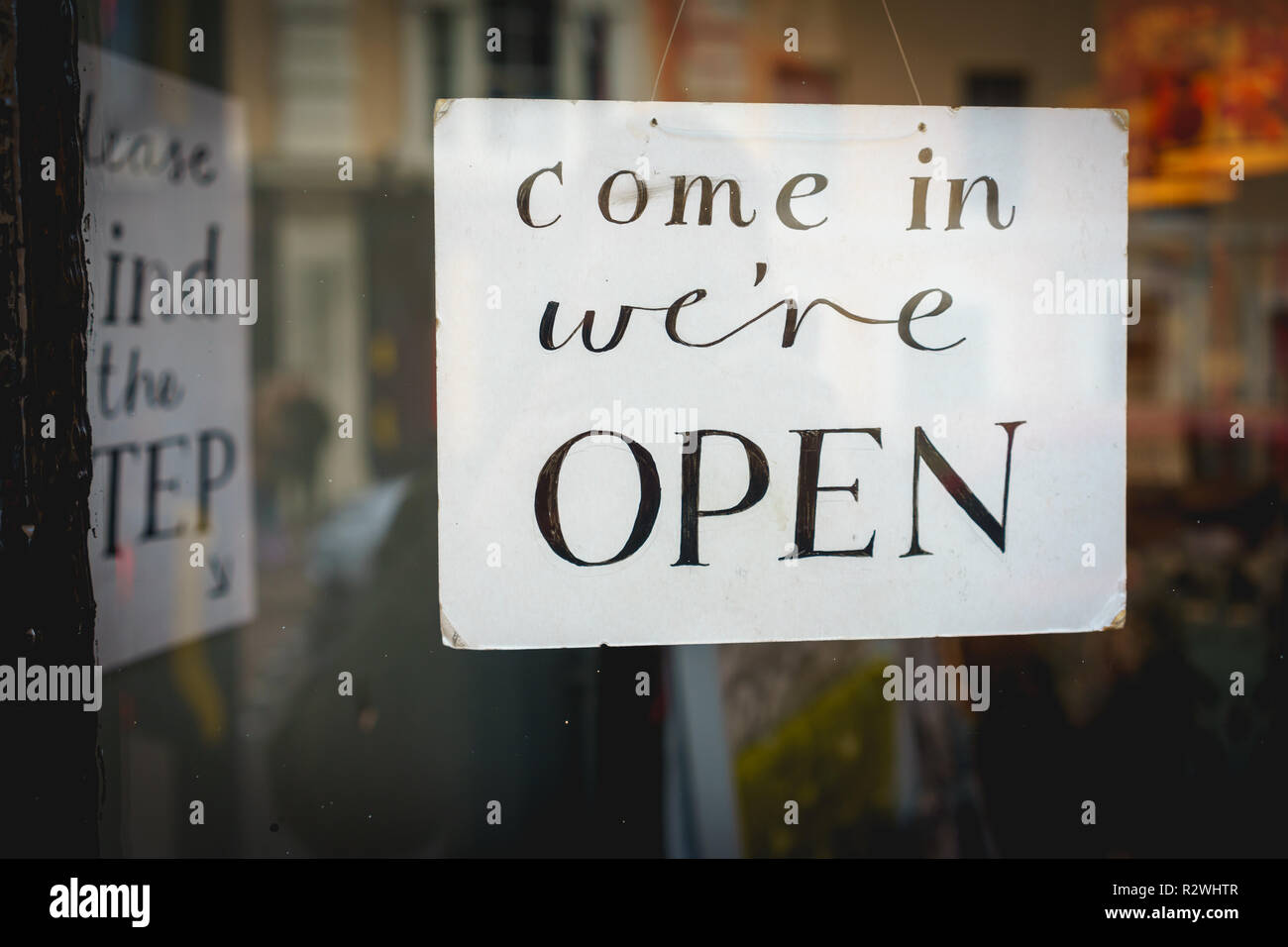 Open sign on a window shop . Landscape format. Stock Photo