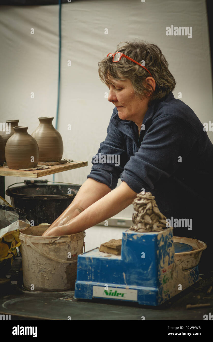 London, UK - January 2018. A female potter making handmade pottery in the Greenwich Market. - Stock Image