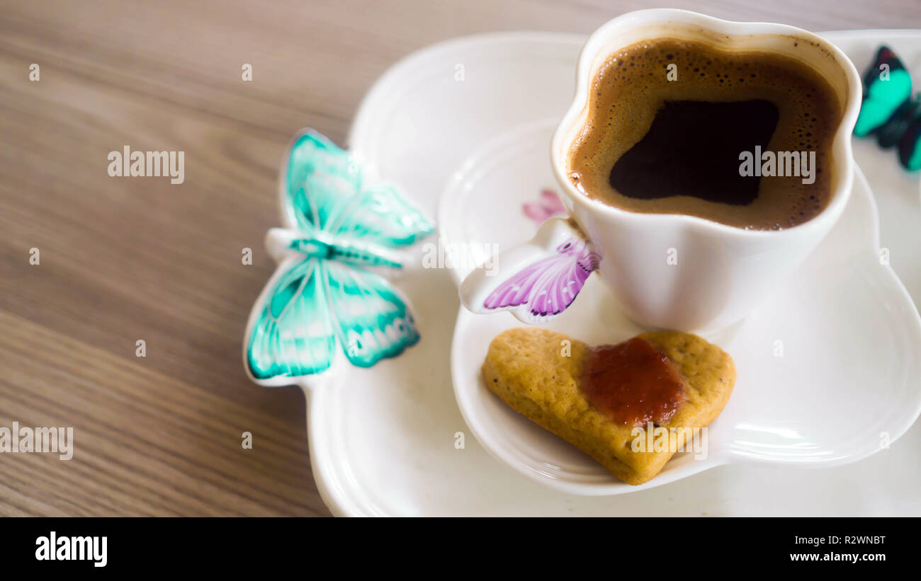 TTurkish coffee and cookies on the table. - Stock Image