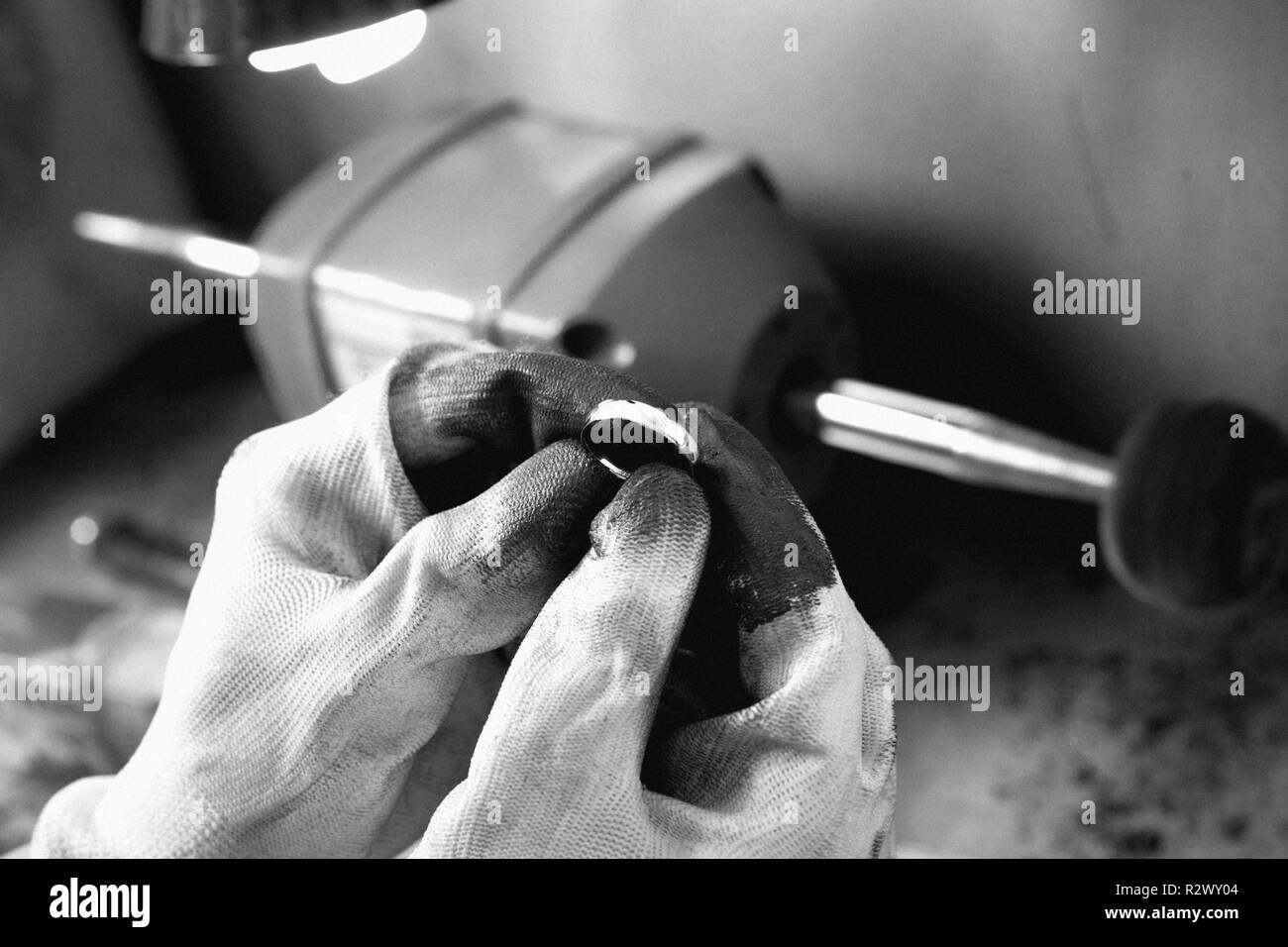 Jeweler at work, crafting in a jewelry workshop. - Stock Image