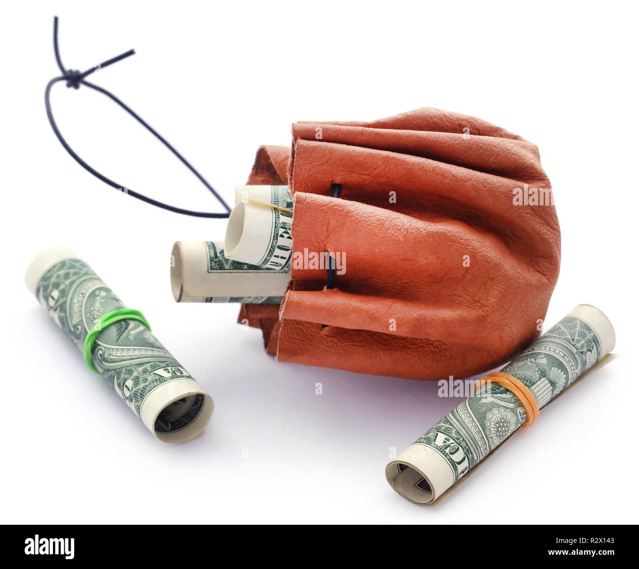 Rolled US Dollar in leather pouch over white background - Stock Image