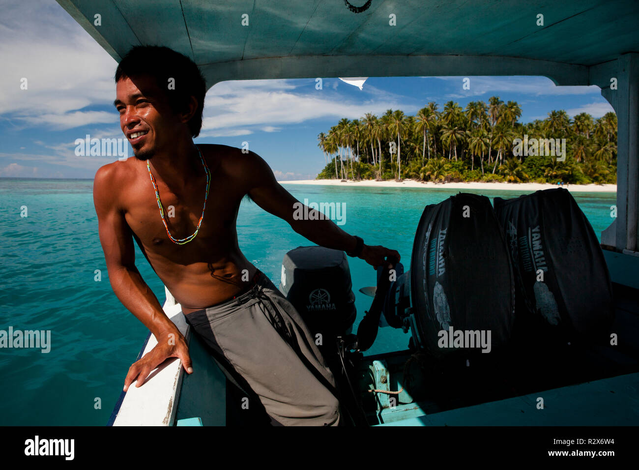 Surf guide Ibrahim guiding a trip to remote surf break 'John Candy's'. - Stock Image