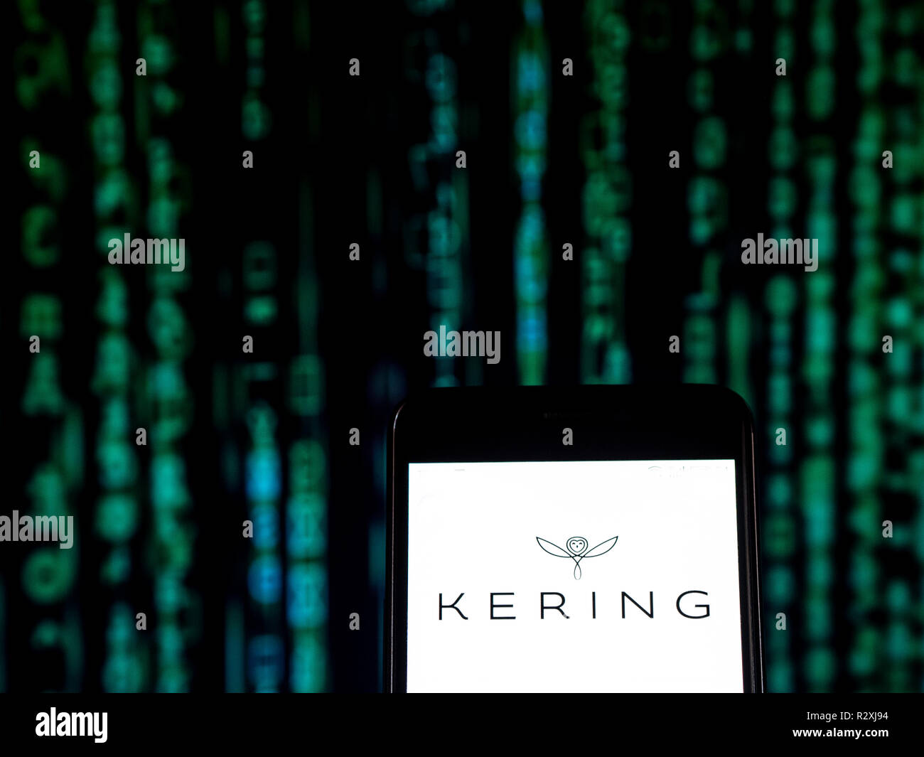7f0076164b5 Kering Luxury goods company logo seen displayed on a smart phone. Kering  S.A. is an