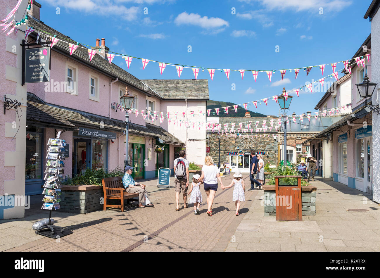 Lake district UK Keswick Lake District people shopping in Packhourse court an enclosed courtyard of shops in Keswick Cumbria England GB UK Europe - Stock Image