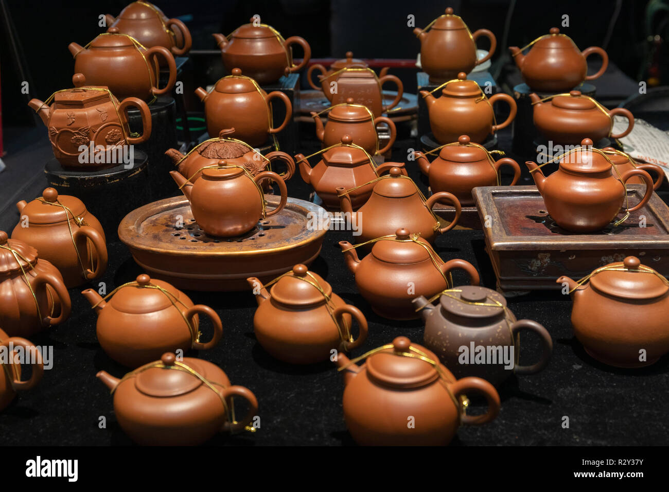 Teapots for sale at the Jianguo Holiday Jade Market in Taipei which is open every weekend, sellingjade as well as other handicraft and jewelry - Stock Image