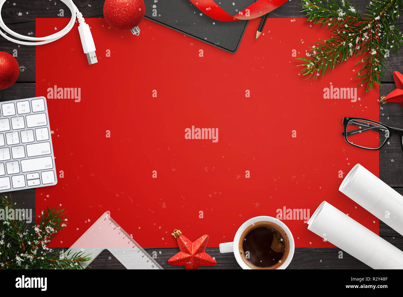 . Tech devices and Christmas decorations on deks  Red table cloth in